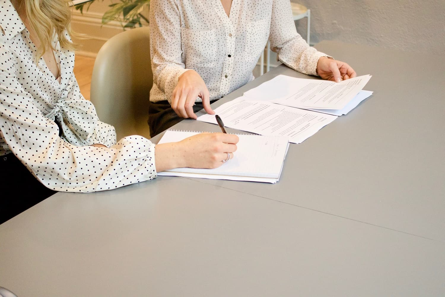 woman signing non-disclosure agreement