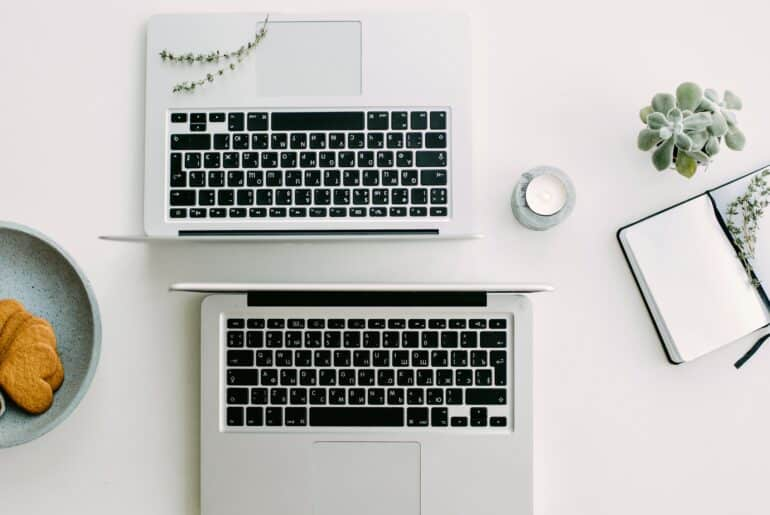 two laptops - online writing jobs for beginners