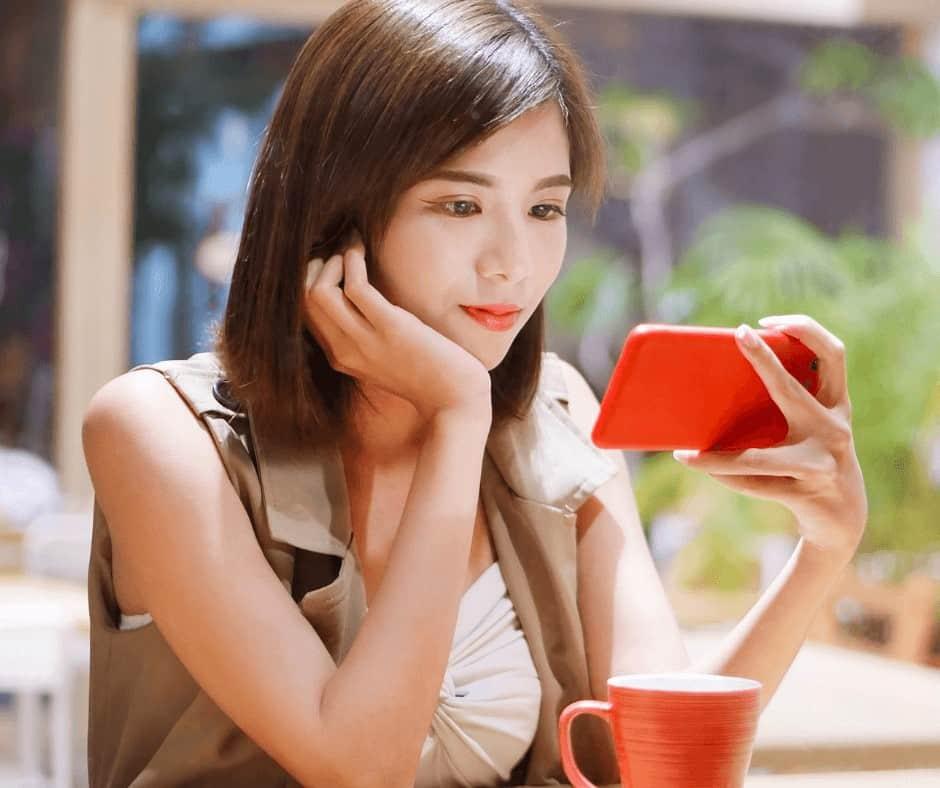 woman looking to earn money watching videos online